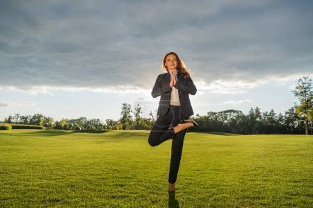 businesswoman practicing yoga