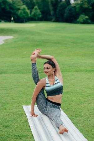 young woman performing yoga pose