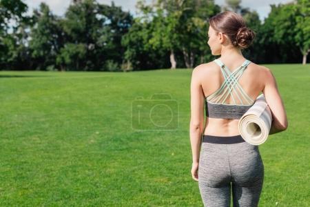 Caucasian woman with yoga mat