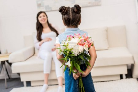Girl hiding bouquet behind back