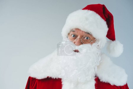 Photo for Close-up portrait of santa claus in hat and eyeglasses looking at camera isolated on white - Royalty Free Image