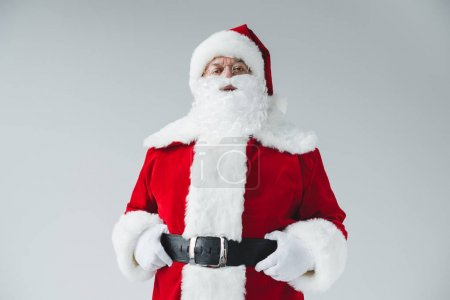Photo for Portrait of confident santa claus holding belt and looking at camera - Royalty Free Image