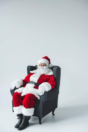 santa claus sitting in armchair