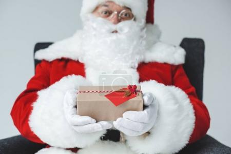 santa claus with wrapped gift
