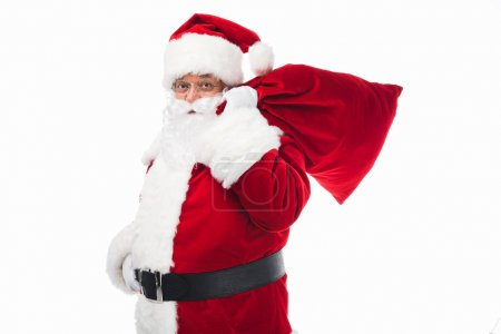 Photo for Santa claus holding bag with presents and looking at camera isolated on white - Royalty Free Image