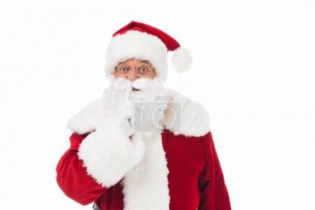 Photo pour Santa claus gestuelle pour silence et regarder la caméra - image libre de droit
