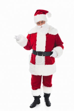 Photo for Full length view of santa claus in traditional costume looking at camera isolated on white - Royalty Free Image