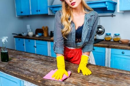 Housewife cleaning tabletop