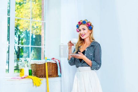 Photo for Attractive blonde smiling housewife having coffee break - Royalty Free Image