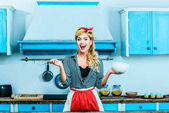 housewife cooking in kitchen