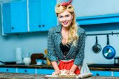 ousewife kneading dough