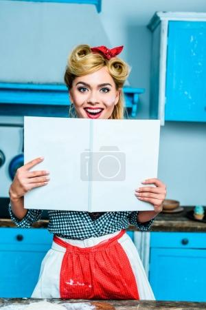 housewife showing cookbook