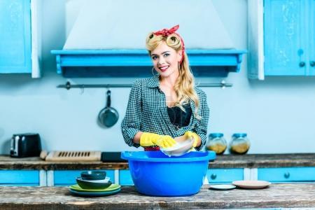 Housewife washing dishes