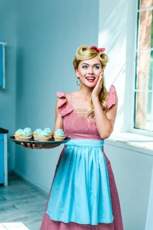Pin up woman with cupcakes