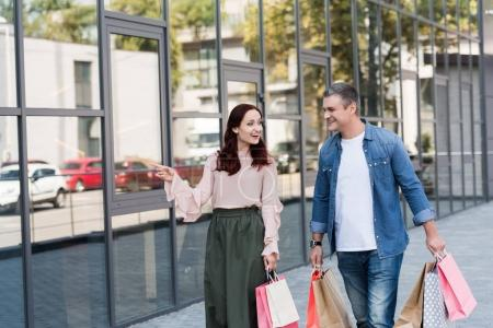 Mature couple with shopping bags