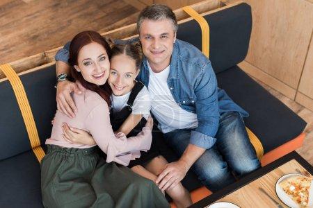 Happy family in cafe
