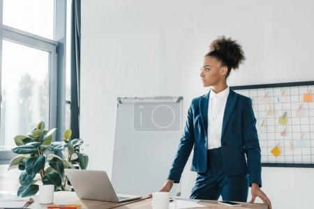 Photo for Beautiful serious african american businesswoman looking away in office - Royalty Free Image