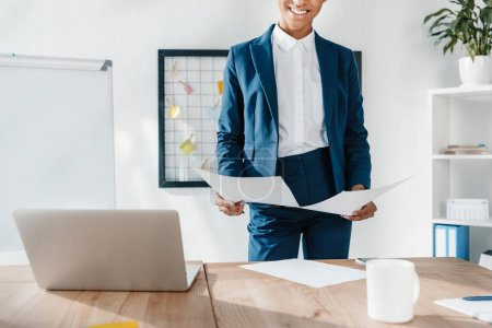 businesswoman holding papers