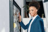 african american businesswoman with sticky notes