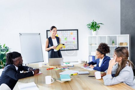multiethnic business coworkers at meeting