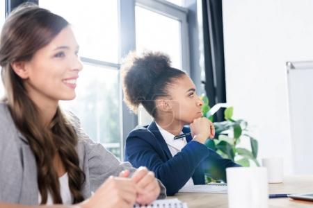 Young businesswomen working together