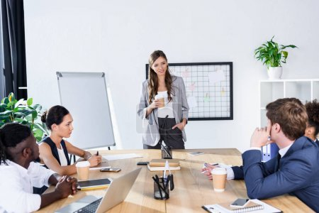 Photo for Multicultural business people discussing new strategy at meeting in office - Royalty Free Image