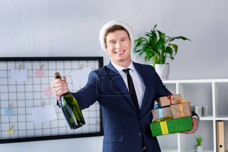 Businessman with gifts and champagne