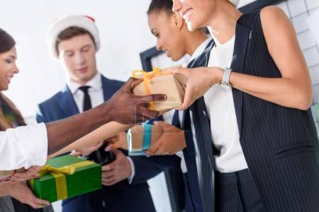 business people with gifts in office