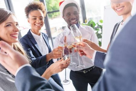 colleagues drinking champagne in office