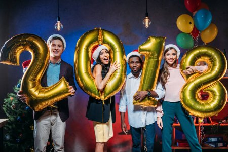 Young friends with golden balloons