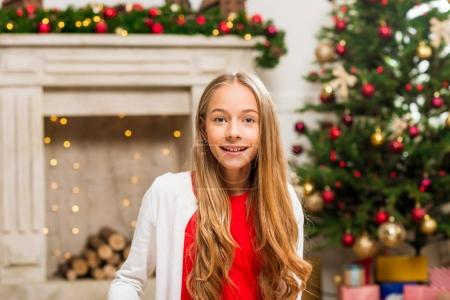 girl in christmas decorated room