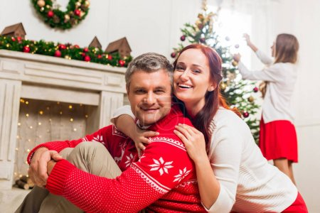 mature couple embracing on christmas