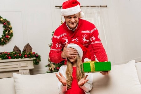 father making surprise gift for daughter