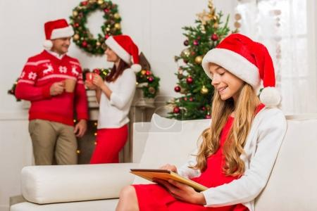 teen girl with tablet on christmas