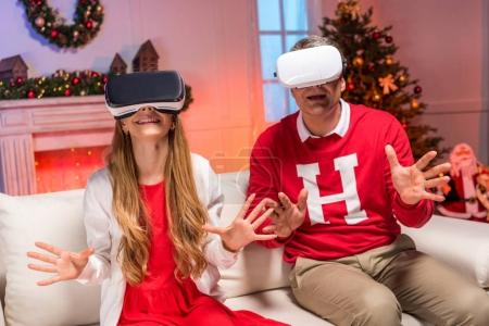father and daughter in vr headsets
