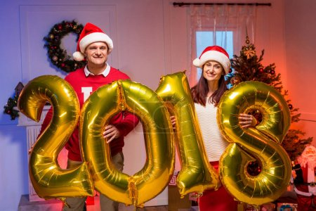 couple with new year balloons