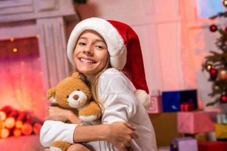 Teen girl hugging teddy bear