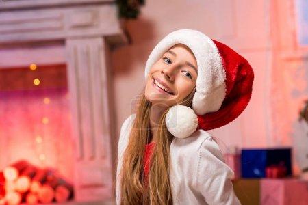 teen girl in santa hat