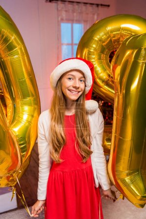 teen girl with new year balloons