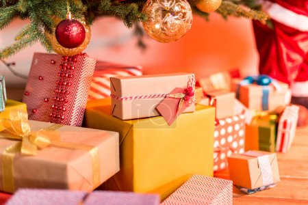 Photo for Beautiful colorful gift boxes under christmas tree - Royalty Free Image