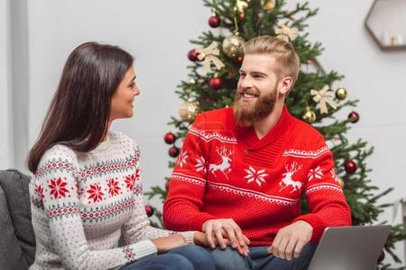 couple using laptop at christmastime
