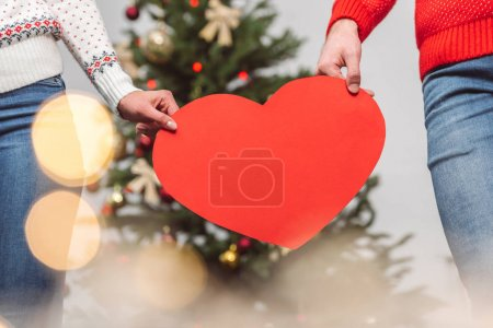 couple holding heart symbol