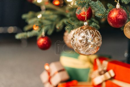 Photo for Close-up view of decorative red and golden baubles hanging on christmas tree - Royalty Free Image