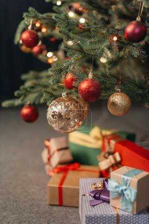 Photo for Close-up view of shiny red and golden baubles hanging on christmas tree - Royalty Free Image