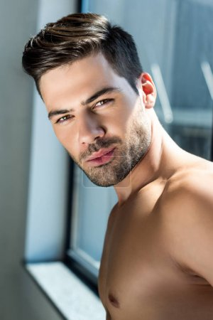 Man standing at window