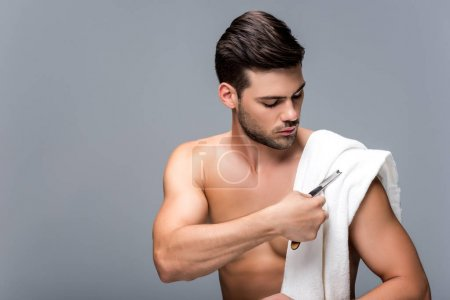 Man with straight razor and towel