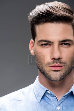 Photo for Close-up portrait of handsome young man looking at camera - Royalty Free Image