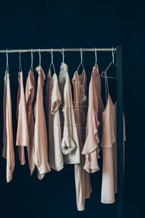 Photo for Close up view of arranged feminine clothing hanging on clothes rack - Royalty Free Image