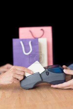 Photo for Cropped shot of woman making payment with credit card in store - Royalty Free Image
