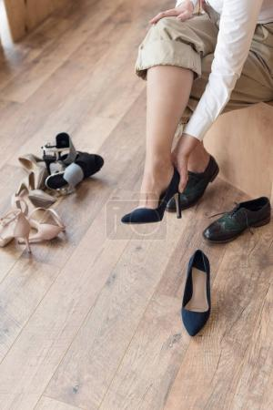 woman wearing shoe in clothing boutique